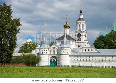 Holy gate and St. Nicholas church of the Svyato-Vvedensky Tolgsky convent in the summer landscape. Yaroslavl the Golden ring of Russia