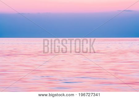 Calm on the sea after sunset in the summer evening