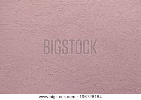 Pink painted stucco wall. Background texture.