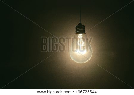 light bulb on dark background concept of creativity.