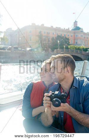 Amorous couple sightseeing on cruise tour