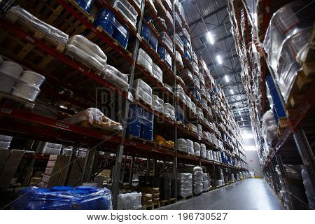 Low angle view of shelves and racks in empty warehouse