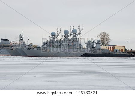 SAINT PETERSBURG, RUSSIA - JANUARY 25, 2017: Small anti-submarine ships of the Baltic Navy in winter parking on a gloomy January day. Kronstadt