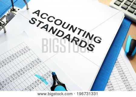 Folder with documents accounting standards on a table.
