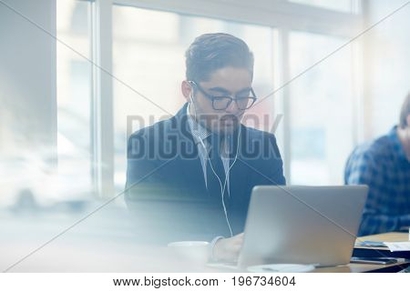 Contemporary businessman taking distant course of study