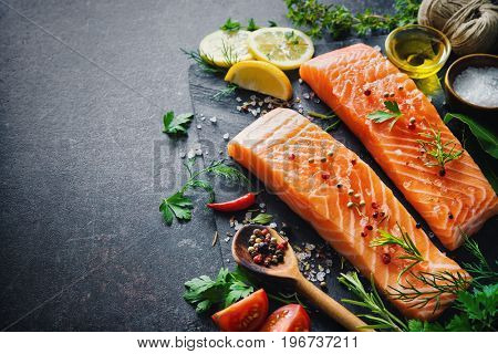 Fresh salmon fillet with aromatic herbs, spices and vegetables. Balanced diet or cooking concept
