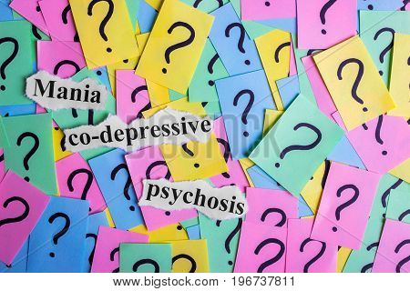 Mania co-depressive psychosis Syndrome text on colorful sticky notes Against the background of question marks