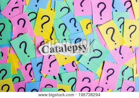 Catalepsy Syndrome text on colorful sticky notes Against the background of question marks