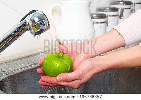 Green Apple In The Sink