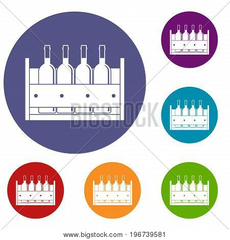 Four bottles of wine in a wooden box icons set in flat circle red, blue and green color for web