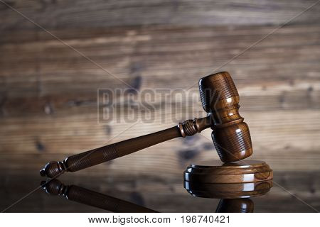 Mallet of the judge. Law. Wooden background.