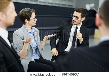 Business people having group therapy for social skills training