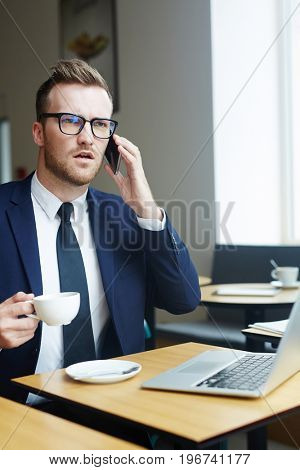 Young lawyer making an appointment with client by smartphone
