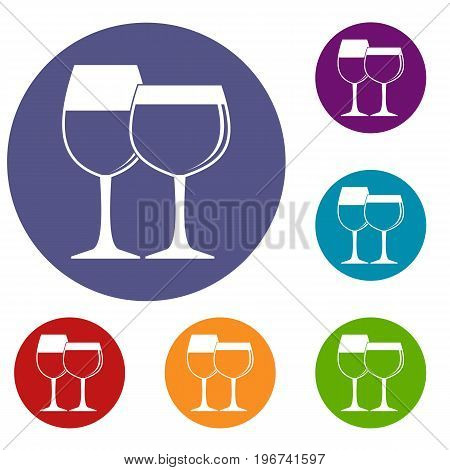 Two glasses of wine icons set in flat circle red, blue and green color for web