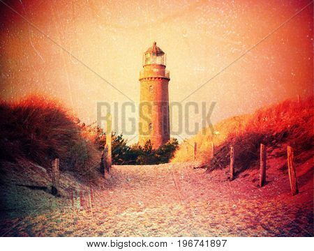 Film Effect. Historical Lighthouse. Shinning Lighthouse,  Dunes And Pine Tree. Tower Illuminated Wit