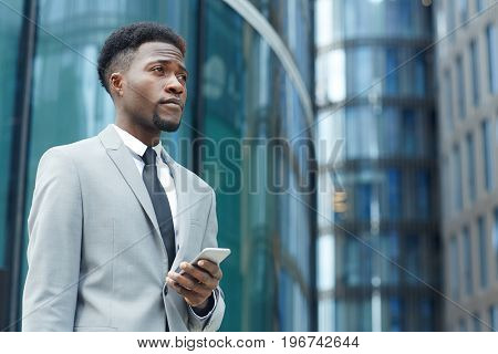 African-american man in suit in urban environment