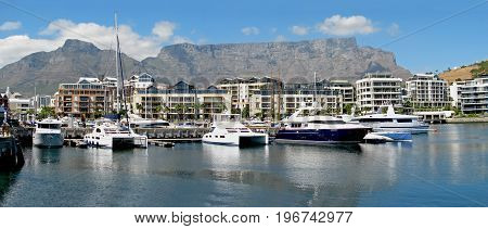 FROM CAPE TOWN, SOUTH AFRICA, VICTORIA AND ALFRED WATERFRONT  ON A SLIGHTLY OVERCAST DAY
