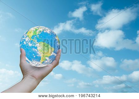 World Human hands the sky in the background blurred.God created the world.Environment Day Ecology concept.Elements of this image furnished by NASA.