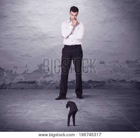 Angry big manager looking at small business man concept on background