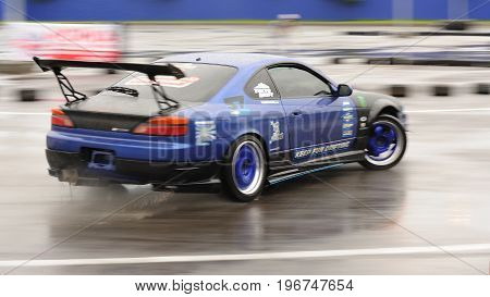 Orel Russia July 22 2017: Dynamica car festival. Drift ride of new tuned car motion blur
