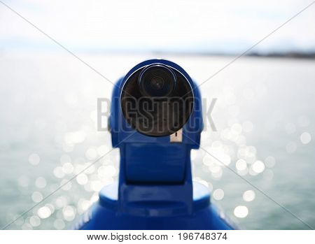 Close-up Binocular And Ocean Background With Beautiful  Blurry Bokeh