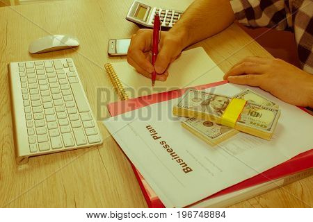 Businessman writing in a notebook. Man Working Determine Workspace Lifestyle Concept make a Note idea analysis. Businesses concept - Retro color