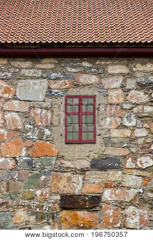 Window in stone wall - architecture background