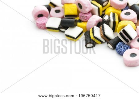 Mixed liquorice candies isolated on white background.