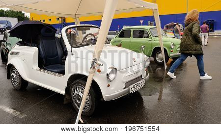 Orel Russia July 22 2017: Dynamica car festival. White cabriolet made from vintage Soviet Zaporozhets car under tent
