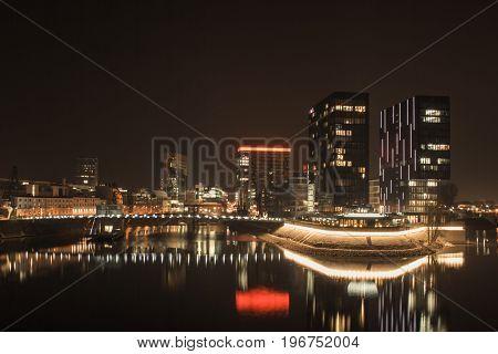 the illuminated Media Harbor in Dusseldorf at night