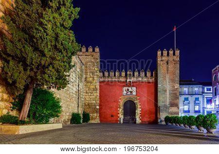 Gates to Real Alcazar Gardens in Seville Spain - architecture background