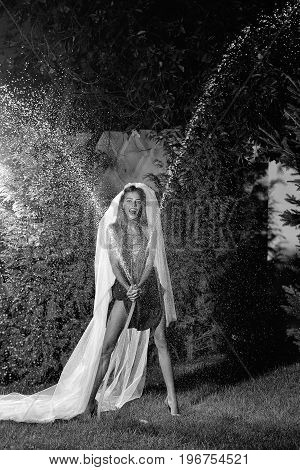 Wedding Woman In Veil With Hose And Water