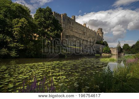 Warwick Castle in the county town of Warwickshire, England, situated on a bend of the River Avon.