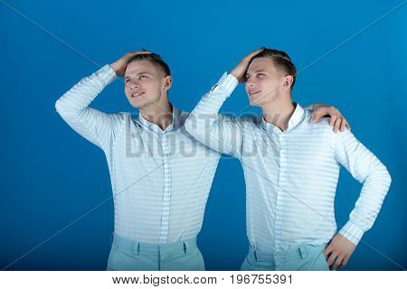 Two Brothers Smiling On Blue Background