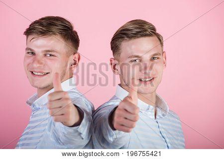Twins Wearing Blue Shirts