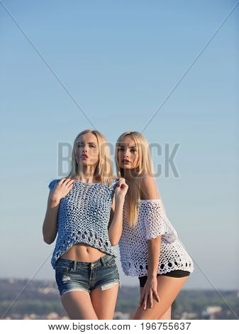 Twins In Summer On Blue Sky.