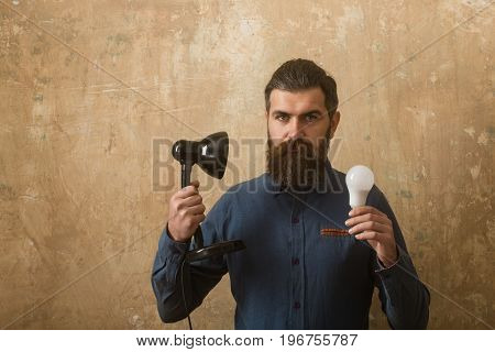 Man With Long Beard Hold Lamp And Bulb