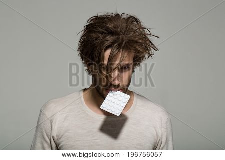 Man With Pills In Blister Pack