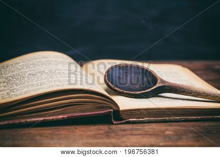 Wooden Spoon On A Vintage Book
