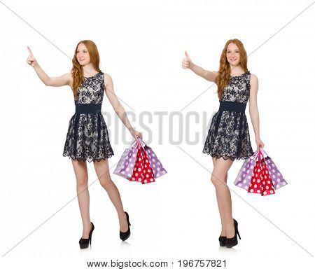 Woman with shopping bags isolated on white