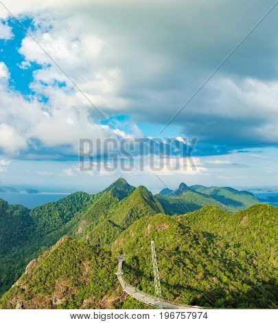 Top view of Sky Bridge and Cable Car with mountains sea and tropical forests in the background, Langkawi island, Malaysia. Langkawi SkyCab is one of the major attractions in the island