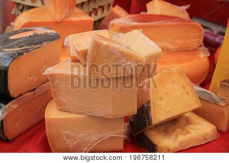 Traditional Dutch cheeses on display on a market stall