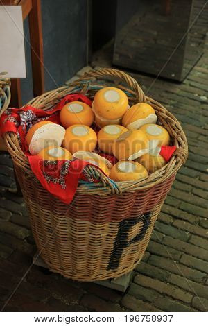 Traditional Dutch cheeses on display in a wicker basket