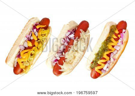 Three hot dogs with an assortment of toppings top view isolated on a white background