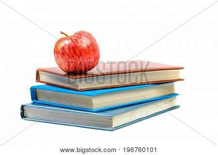 Heap of books with apple isolated on white background