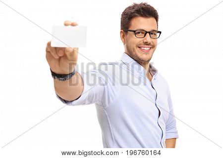 Young man showing a blank business card isolated on white background