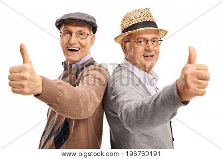 Joyful seniors holding their thumbs up isolated on white background