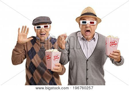 Terrified seniors with 3D glasses and popcorn isolated on white background