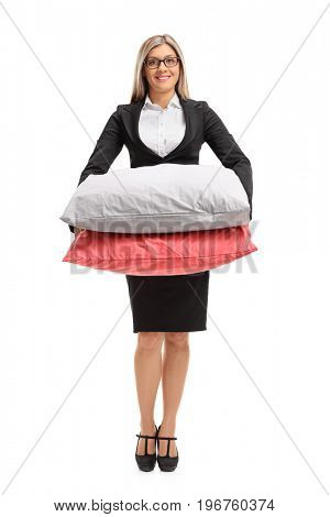 Full length portrait of a formally dressed woman with pillows isolated on white background