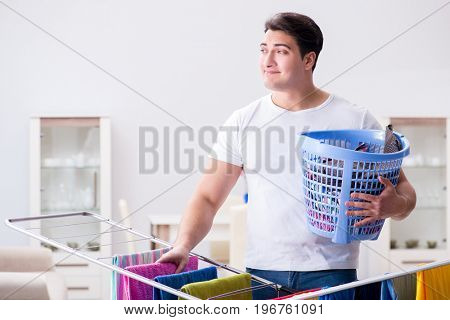 Man doing laundry at home